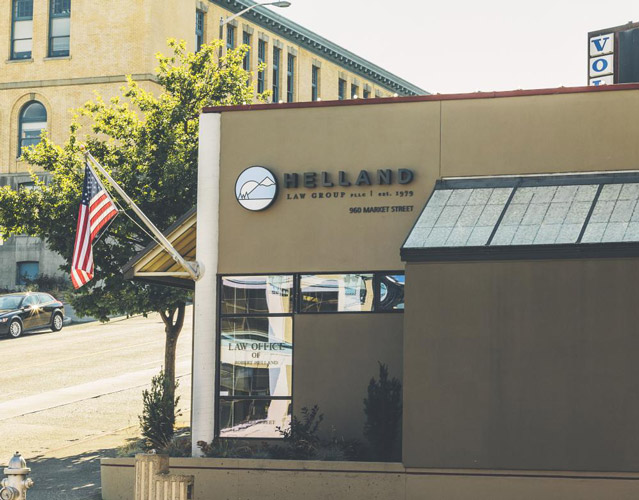 This is an image Helland Law Group's office, where Tacoma Attorneys Robert Helland, Barb McCainville, and Andrew Helland have a general law practice. The photo features a compact, modern building photographed on a sunny da